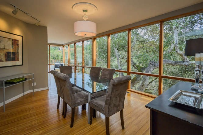 dining room looks out to a canopy of trees