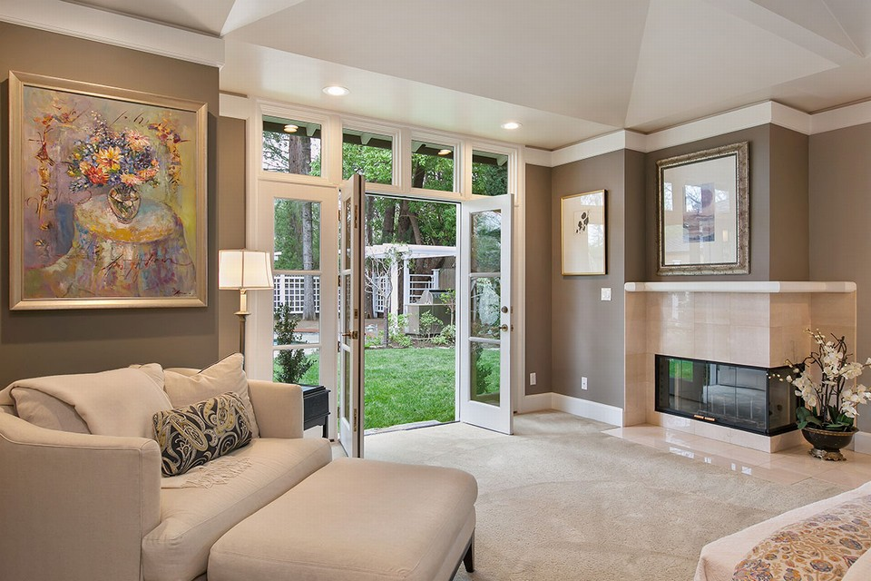 master includes fireplace, his-and-her walk-in closets and french doors to pool and entertainment area