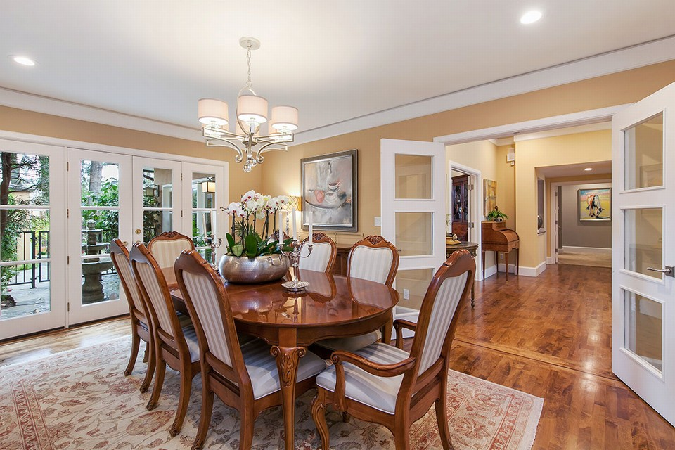 gracious formal dining room with french doors to private courtyard
