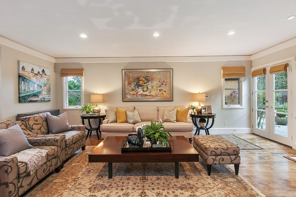 adjacent family room with french doors to pool and outdoor entertaining area