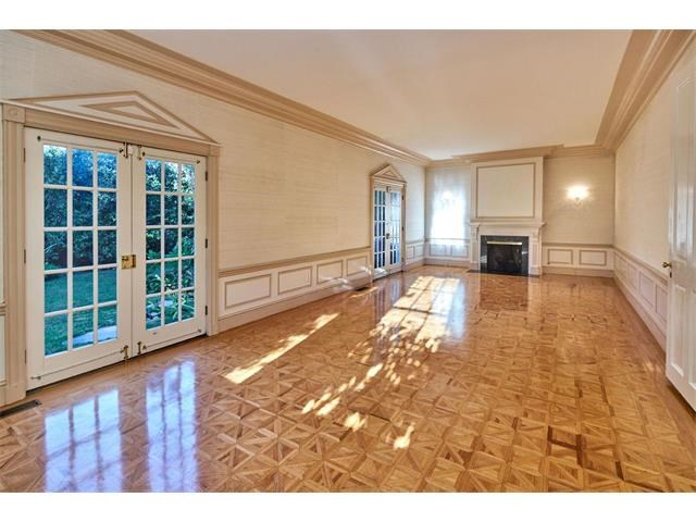 large formal living room with french doors leading to grassy play area